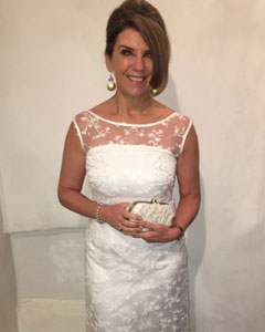 Dr Dawn Harper wearing the Azalia Gown (Ivory)