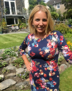 Jasmine Harman wearing the Holly Dress (Midnight Garden)