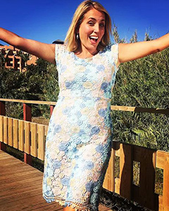 Jasmine Harman wearing the Atlanta Dress (Pastel Daisy)